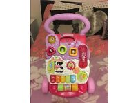 Immaculate baby walker for a little girl, selling because it is not needed anymore