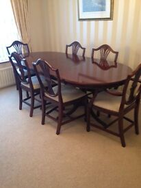 mohogany extending table and chairs