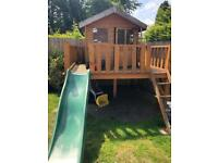 Children's wooden treehouse and slide