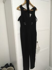 Two of the same Jumpsuits with choker one size 16 and the other 18