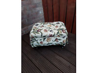 foot stool with patterned padded top and wood legs