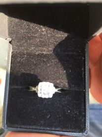 1/2 a carrot dimond engament ring, not old at all very clean and no damages.
