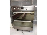 Black and chrome free standing oven grill.