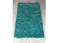 Turquoise/aqua rug for sale - £10