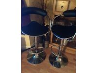 Two black and silver swivel stools