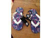 DC women's flip flops, size 3