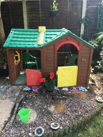 Child's play house, wellloved but sadly outgrown. One half door missing.