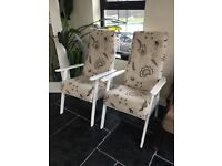 Two arm chairs with high backs