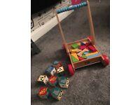 Children's wooden blocks on trolley