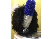 Feather bonnet, new hackle, years old in excellent condition.