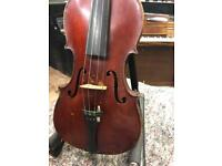 Old violin with case and bow.