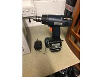 Battery drill with charger