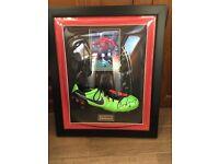Framed football shoe