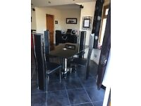 Black and chrome table and chairs