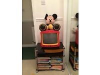 Mickey Mouse TV & DVD player c/w black glass to stand and a large Mickey Mouse cuddly toy