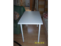 """Small white Ikea table """"Adils"""" with tubular white legs. Very good condition."""