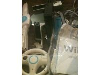 Black nintendo wii with 2x contollers and lots of accesories