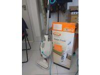 Steamer + detergent and accessories