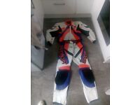 Hi I am selling this two-piece leather motorcycle suit