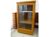 Wooden cupboard with glass door
