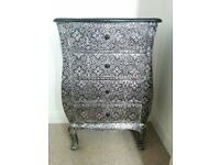Ornate metallic small chest of drawers