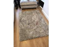 Neutral coloured shaggy rug