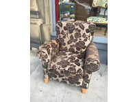 Modern upholstered chair , in good condition. In a brown material with pattern. Free local delivery.