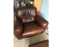 Brown leather armchair with matching footstool