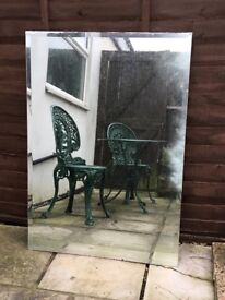 Free on collection, 2 used, bevelled edged wall mirrors. One 730 x1040mm and the other 780x1200mm