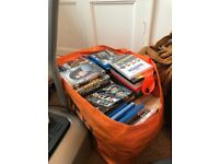 Over 100 books/dvd some new