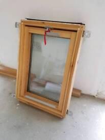 Loft centre pivot window