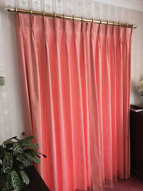 Two sets of Rose coloured lined curtains with brass effect curtain poles
