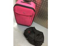 Pink Suitcase and Black bag