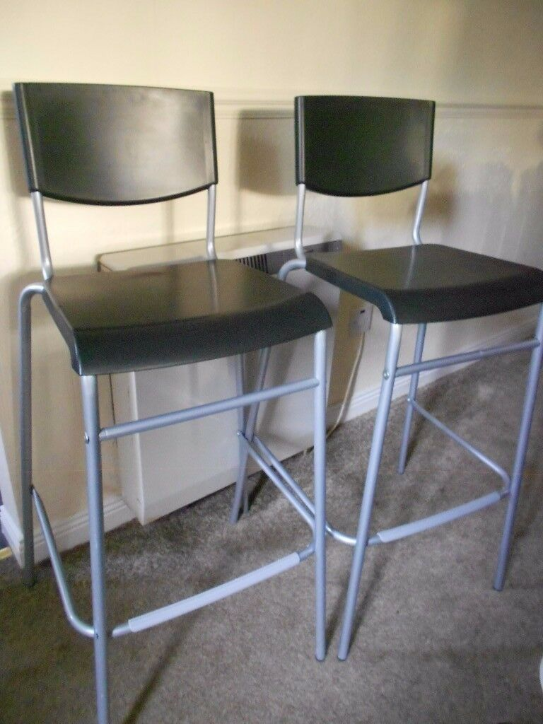 Two bar stools with backrest
