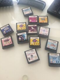 Black Nintendo DSi with games and charged