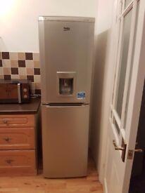 Beko fridge freezer with water dispenser.