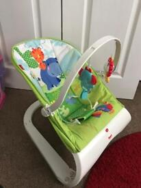 Fisher Price Rainforest vibrating bouncer chair with hanging toys. Excellent Condition.