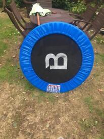 Trampoline with safety bounce bar