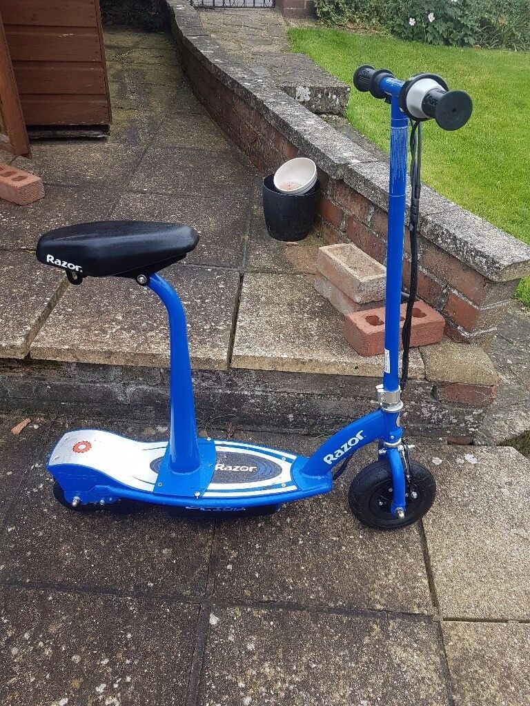 Electric razor seated scooter