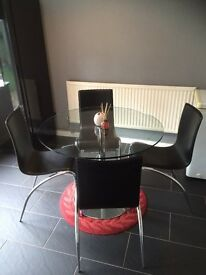 Tempered Glass Round Shaped Dining Table and 4 Black Leather Chairs
