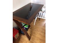 Lovely glass and wood desk. Beautiful piece of furniture