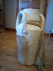 A floor standing vase in cream