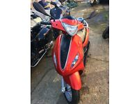 Burnt Red Piaggio Fly 50