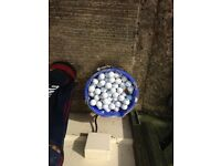 Golf clubs and large selection of golf balls