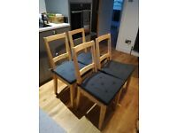 Four chairs with grey seat pads