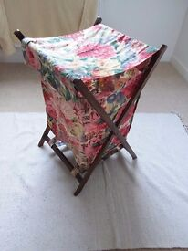 Laundry basket, dark stained with a Sanderdon floral fabric . Flap over to hide the washing