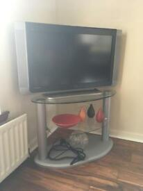 """TV - 32"""" Goodmans HD TV with stand."""