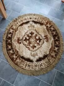 Brown circular rug