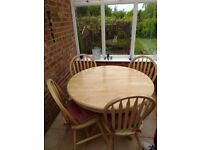 Circular table and 4 chairs with seat pads