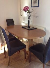 Dining table and four faux leather chairs in good condition